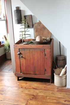 Love everything about this.  the understairs cubby, the beautiful floor - and the dry sink.  Love!!!