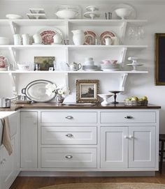 open kitchen shelving shows off a beautiful, thoughtful collection of dishes