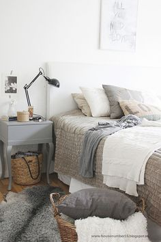 Monochromatic often becomes dull and boring. Not so with this room. The use of many shades of gray and abundant texture make this room cozy and inviting.