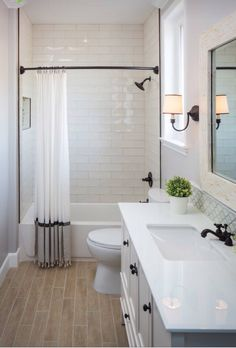 Subway tiles and tile floor that has a wood finish