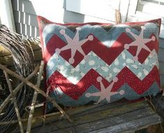 Make this Zigzag Snowflake Patchwork Pillow to give your home a festive, winter feel.