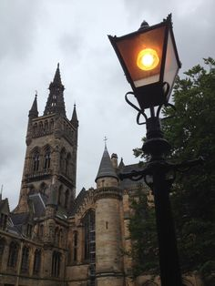 University of Glasgow Gothic Tower and Street Lamp Glasgow University, University Life, 365days, The Secret History, Gothic Architecture, West End, Travel Aesthetic, Looks Cool, Light In The Dark