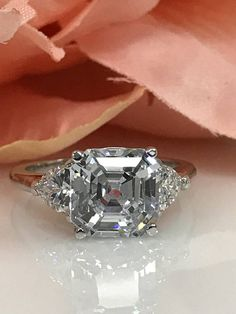 Asscher Cut Engagement Wedding Anniversary Promise With Trillion Accents Ring Solid White Gold by InfinityJewelersUSA on Etsy Leaf Engagement Ring, Dream Engagement Rings, Three Stone Engagement Rings, Vintage Engagement Rings, Unique Rings, Beautiful Rings, Asscher Cut, Wedding Anniversary, White Gold