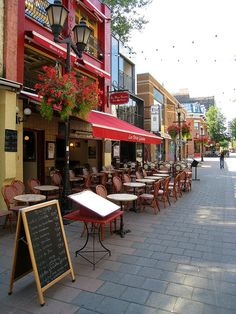 rue Prince Arthur in Montreal.  Sit down at an outdoor cafe and enjoy the sunshine.