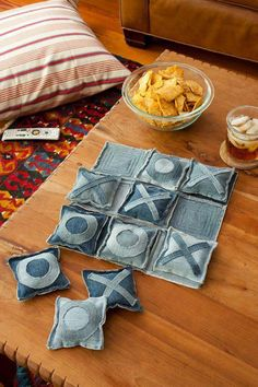 """Use old jeans, cut into squares, add some batting material to the center, sew edges together. Either sew or draw the """"X"""" and """"O"""" onto them and instant tic tac toe game for kids! (Use Dad's jeans.)"""
