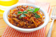 Lentil chili is deliciously offbeat, especially with the addition of sweet potato. Smoky spices add a bold but not overly hot flavor to the stew.
