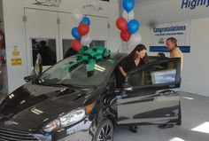 East and Greenwell Insurance helps in car donation for Englewood family