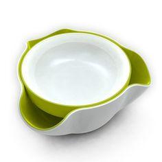 Petisqueira Double Dish  Com o Double Dish Joseph você irá providenciar a solução perfeita para servir snacks como pistache ou azeitonas, sem que seus convidados fiquem vendo as cascas ou os caroços. Graças ao seu sistema Shells, você pode jogar os restos na parte de baixo da petisqueira onde ficam escondidas, deixando sua casa sempre organizada.    Você pode utuilizat os 2 pratos separadamente para colocar tipos diferentes de Snacks.