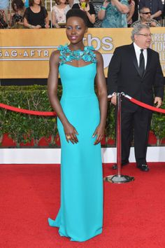 """""""12 Years a Slave"""" star Lupita Nyong'o continued to develop her signature style of monochrome dresses with a turquoise gown featuring floral accents. The actress picked up the award for Outstanding Performance by a Female Actor in a Supporting Role for """"12 Years a Slave."""""""