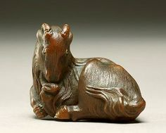 Netsuke in the form of a goat. Ashmolean Museum.