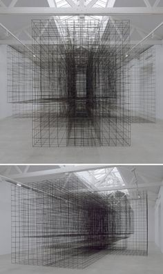 Installation by Antony Gormley comprising an impenetrable structure made from grids of steel