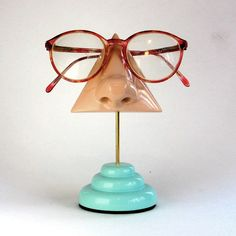 Nose Eyeglass Holder, fun idea to have sitting next to the computer, Right?  $35.00 on etsy.com