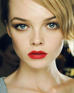 contouring eyes and cheeks and a red lip