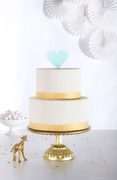 Whether you're celebrating a wedding, birthday or baby shower, this gorgeous blue cake topper makes even the most simply decorated cake feel festive with a pop of color! #wedding