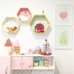 Filled with @kid.candy.co goodies, this corner of the playroom is shaping up to be quite yummy! I've done a hack on the hexagon shadow boxes & they now match the kids' kitchen with their @lovemaestudio backing. Still a WIP, I'm excited to see the playroom coming together! 😄🍦🍩🍉🍐🍓#wip #playroom #kidsroom #play #playkitchen #playfood #kidcandygoodies #icecream #donut #cupcake #pear #strawberry #prints #sonnyangels #typo #typohack #kmartaus #kmarthack #lovemae #cherishmadehope
