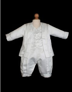 Boys Christening Outfit style i346b by Sweetie Pie Collection is a satin boys pant and jacket christening set. It comes with a matching bonnet.