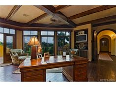 Traditional home office - wood floors and beams - arches.  Colliers Reserve in Naples, FL