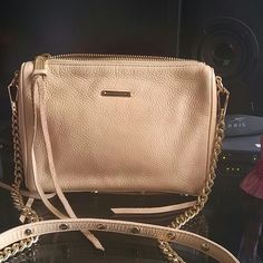 "⬇Rebecca Minkoff Malaga Zip Crossbody Gold-toned zippers garnished on richly grained genuine leather shapes a sleek crossbody suspended from a removable, chain crossbody strap for a versatile moto look. - Detachable partial chain shoulder strap - Top zip closure - Exterior features gold-tone logo hardware accent, triple zip pockets, and metal feet - Interior features wall zip pocket - Approx. 6.5"" H x 8.5"" W x 1.25"" D - Approx. 21"" strap drop Rebecca Minkoff Bags Crossbody Bags"