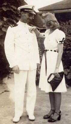 Wife and her Sailor -1940s  Great detail on dress, ribbon woven through large button holes or belt loops.