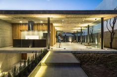"""House which manifests its character with an apparent concrete wall and with wooden access doors Architects:Taller5 Arquitectos Location:Leon, Guanajuato, Mexico Year: 2016 Area: 1.937 ft²/ 180 m² Photo courtesy:Oscar Hernandez Description: """"The GP House project is the result of a clear definition of needs and an excellent relationship with the client, which clearly expressed their …"""