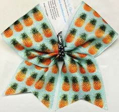 Bows by April - Pineapples Preppy Patterns Glitter Cheer Bow, $15.00 (http://www.bowsbyapril.com/pineapples-preppy-patterns-glitter-cheer-bow/)
