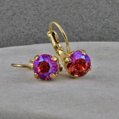 Handmade Padparadscha Shimmer F 39ss 8.5mm Earrings on Gold Lever Backs OOAK by oscarcrow on Etsy