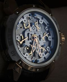 Mechanical watch with six retrograde seconds hands. Each seconds hand measures 10 seconds in order, then resets.