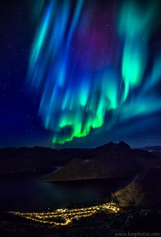 Aurora Borealis above the beautiful village Fjordgård on Senja