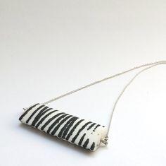 Pilar Rojas. Pillow pendant. Porcelain and silver.