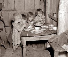 A group of children at Christmas Dinner in 1936. The children are eating cabbage and turnips. This photograph truly makes me realize how fortunate I am, and how lucky we are today to have plenty to eat, and a warm and safe place to live.