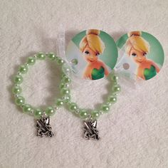 8  Tinkerbell Charm Bracelet With Ribbon Tag by MichelleAndCompany