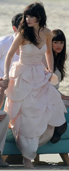 Zooey in pink strapless scalloped gown for a New Girl photoshoot