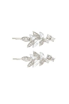 bc14a146a38 A pair of high-polish hair pins featuring a foliage design with rhinestones  and faux