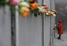View A young girl places a rose at the memorial in Bernauer Strasse during a ceremony marking the anniversary of the fall of the Berlin Wall, in Berlin, Nov. pictures and other This Week in Pictures: Top Photos from Around the Globe photos at ABC News