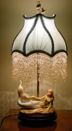 Amazing Mermaid Lamp. Love the bead detail on the shade!