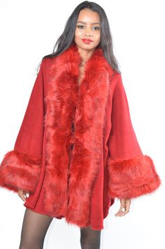 Vegan fur never looked so good! Absolutely stunning. Cape features huge cuffs and collar. Open style front and sides with hook at neck. Super soft sweater knit. Draped style that will fit most sizes.