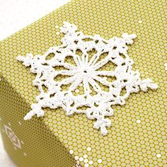 a Snowflake Gift Topper Let a simple snowflake crochet pattern dress up your gifts this holiday season.Let a simple snowflake crochet pattern dress up your gifts this holiday season. Crochet Snowflake Pattern, Crochet Motifs, Crochet Stars, Crochet Snowflakes, Crochet Flowers, Crochet Patterns, Crochet Angels, Diy Snowflakes, Christmas Snowflakes