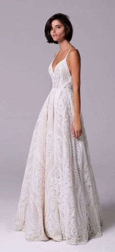 f1c1c0c6df07 Romantic vintage voluminous dress embellished with crystals and beads that adorn  the neckline spaghetti strap crochet lace full skirt wedding dress   Michal  ...