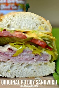 This delectable easy Po Boy Sandwich also know as a Poor Boy sandwich combines ham, Swiss, shredded lettuce, tomatoes and pickles all on soft french bread spread with an easy three ingredient mayo. Sandwich Buffet, Po Boy Sandwich, Best Sandwich, Soup And Sandwich, Sandwich Ideas, Mayo Sandwich, Chicken Sandwich, Deli Sandwiches, Delicious Sandwiches