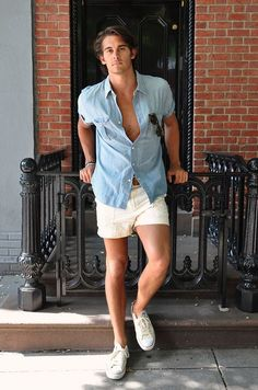 A light blue chambray short sleeve shirt and beige shorts are both versatile menswear must-haves that will integrate nicely within your off-duty wardrobe. If not sure about what to wear when it comes to shoes, go with a pair of white canvas low top Summer Outfits Men, Summer Wear, Short Outfits, Casual Summer, Summer Chic, Classic Outfits, Summer Shorts, Summer Clothes, Spring Outfits