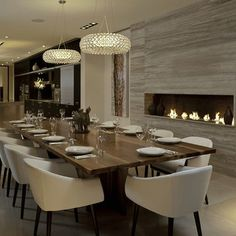 Linear Fireplace with Travertine, Warm Wood Table/Cream Chairs