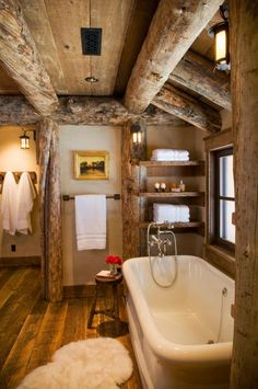 With its exposed timber frames, this bathroom feels like it's been plucked straight from the Alps!