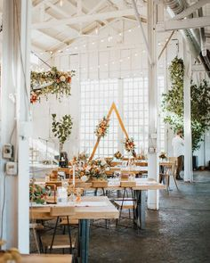 We are loving the blend of boho chic and modern rustic styles happening with this wedding venue. Planning your special day? Head to rusticweddingchic.com for more wedding inspiration! | Photo: @sadie.photog Boho Bride, Boho Wedding, Rustic Wedding, Rustic Style, Modern Rustic, Wedding Decorations, Table Decorations, Boho Chic, Wedding Venues