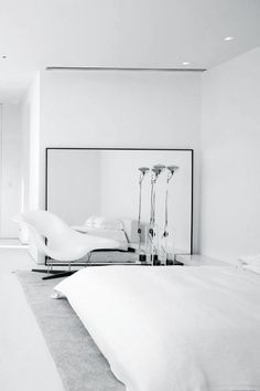 """""""My elegant girl slept on designer sheets / Her sugar free words swayed to a hightech beat / With crazy stories of hatred and hurt..."""" - BRETT ANDERSON - (Total White Minimal Design...Walls, floors, sheets and... the """"Vitra Chaise"""" by Charles Eames)"""