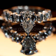 Pear shaped engagement ring with black diamonds