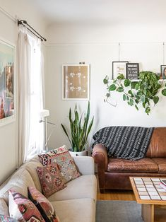 """A Homepolish Pro's Stylish Abode — & How You Can Copy It #refinery29 http://www.refinery29.com/homepolish-san-francisco#slide3 """"I love textiles for all the diversity they bring to a space, both visually and culturally. They make it anything but cookie-cutter. I've collected my kilim pillows from eBay and Craigslist, and I found my black-and-white African mud cloth on eBay. In other rooms, I've even framed textiles as wall art."""""""