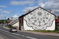 """Exquisite Bobbin Lace Mural Adds a Delicate Touch to a Blank Facade... Warsaw-based artist NeSpoon has recently brought her delicate works to the streets of Bobowa, cloaking a building in a beautiful """"bobbin lace"""" mural. We've long admired her outdoor ornamentation, which can take the form of large-scale paintings or small stamped sculptures. - My Modern Met"""