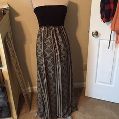 Aztec Maxi Aztec maxi with black tube top. This is Flowy at the bottom and tight/cinching around the chest. Size L from Francesca's. Francesca's Collections Dresses Maxi