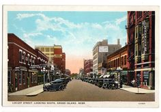 """Vintage circa 1920's postcard """"Locust Street, Looking South, Grand Island, Nebraska."""" Published by C.T. American Art Colored. Postcard number 121689. Measures 5.5 inches wide by 3.5 inches tall. Card"""
