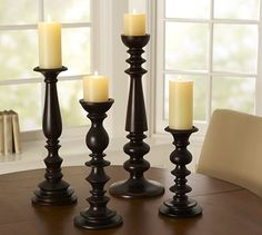 candle sticks ....would love some kinda like these with like grapevine balls or moss balls to set on top